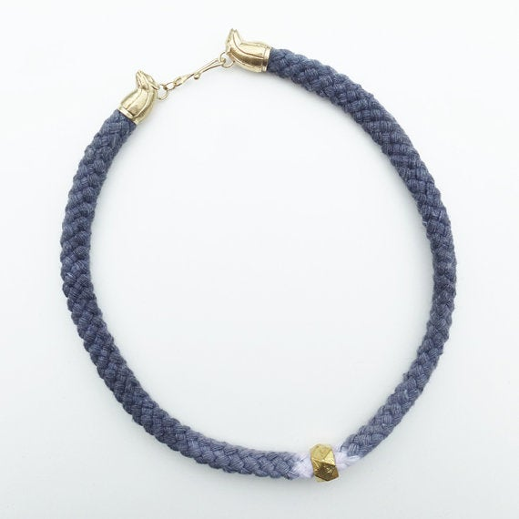 Image of Brass Rat Necklace with Gray and White Cord and Brass Bead