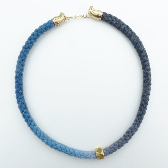 Image of Brass Rat Necklace with Blue and Gray Cord and Brass Bead