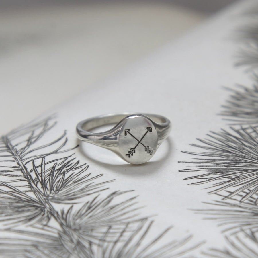 Image of small arrow signet ring