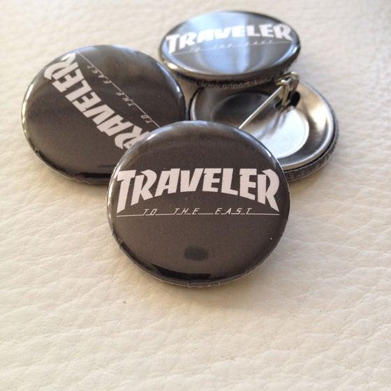 Image of Traveler button.