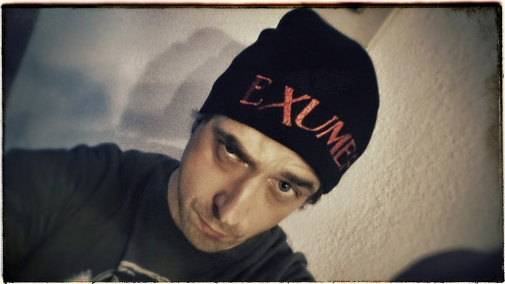 Image of Beanie with embroidered logo
