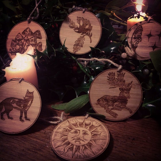 Image of Yule wood cut decorations