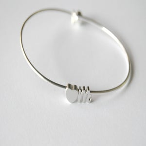 Image of heart with one letter bangle