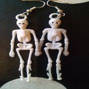 Image of Vintage Plastic Skeleton Dead Body Skull Earrings