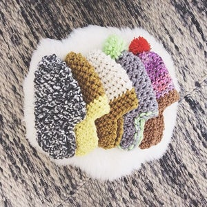 Image of wool hat + earflaps