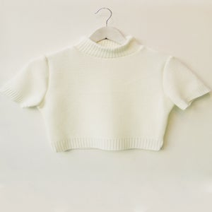 Image of knitted ribbed white turtleneck crop jumper by TLO