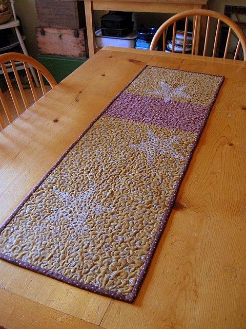 "Image of table runner - 40"" x 13"" - tumbling blocks design reverses to pieced mustard, burgundy"
