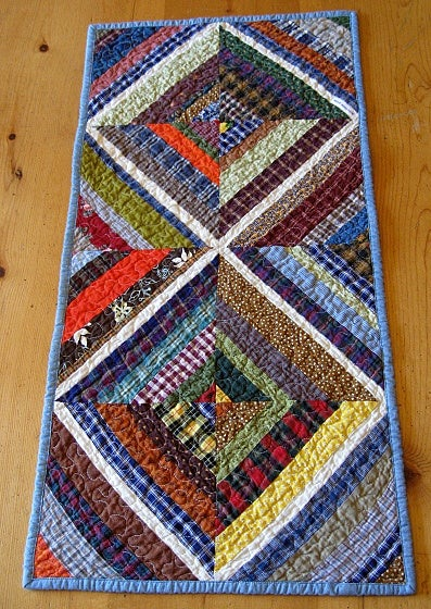 """Image of table runner - 33"""" x 15"""" -  kaleidoscope design reverses to chambray with star design"""