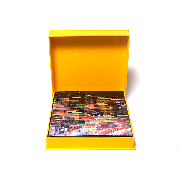 "Image of ""City of Darkness Revisited"" in a clamshell case."