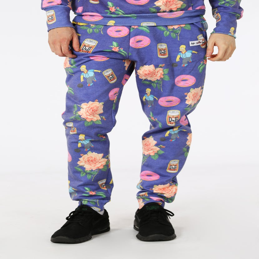 Image of HYPE X SIMPSONS. HOMER FLORAL JOGGERS