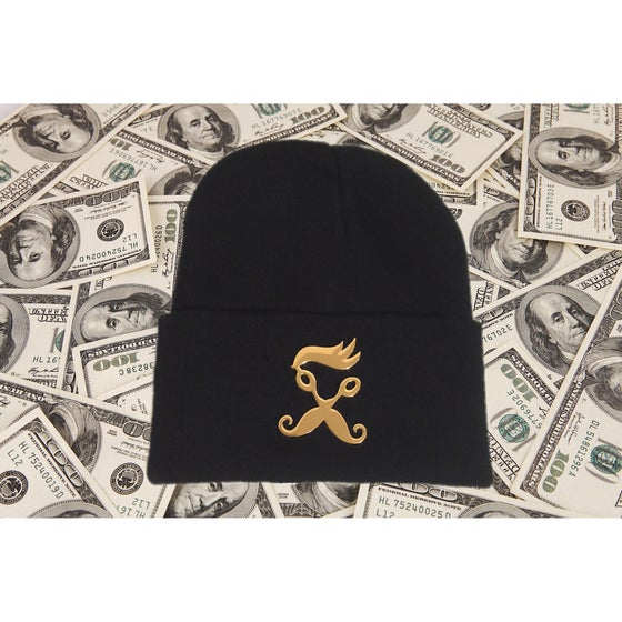Image of Gold metal R.B.S logo pendant on black beanie