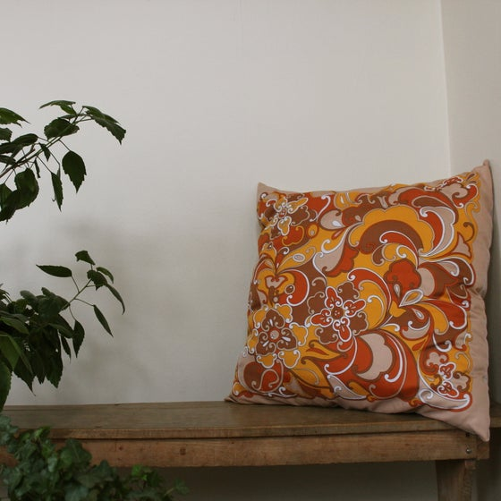 Image of unique cushion made with vintage satin scarf