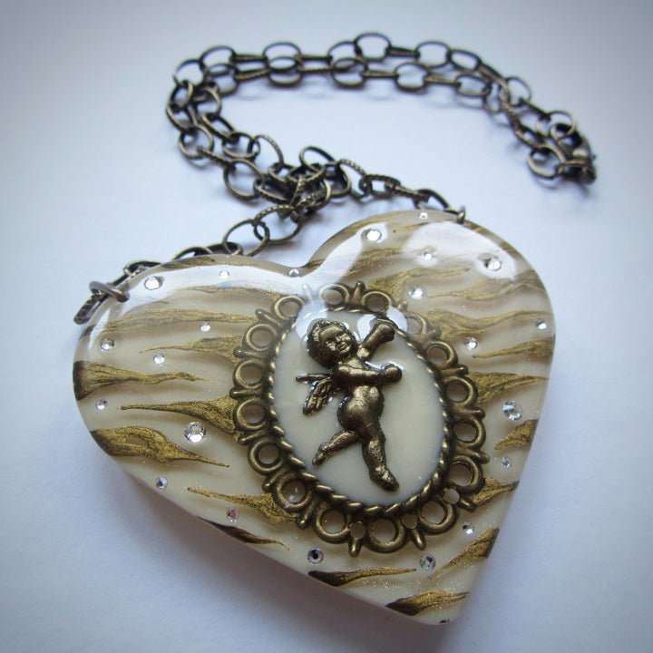 Image of Ivory Zebra Cameo Resin Heart Pendant