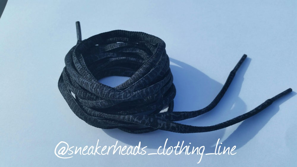 "Image of Exclusive ""BHM/Elephant Print"" Oval Laces (Black)"