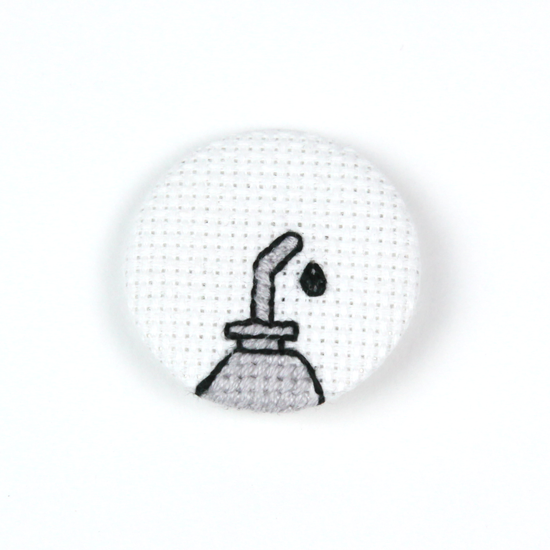 Image of Oil Can Cross-Stitched Button