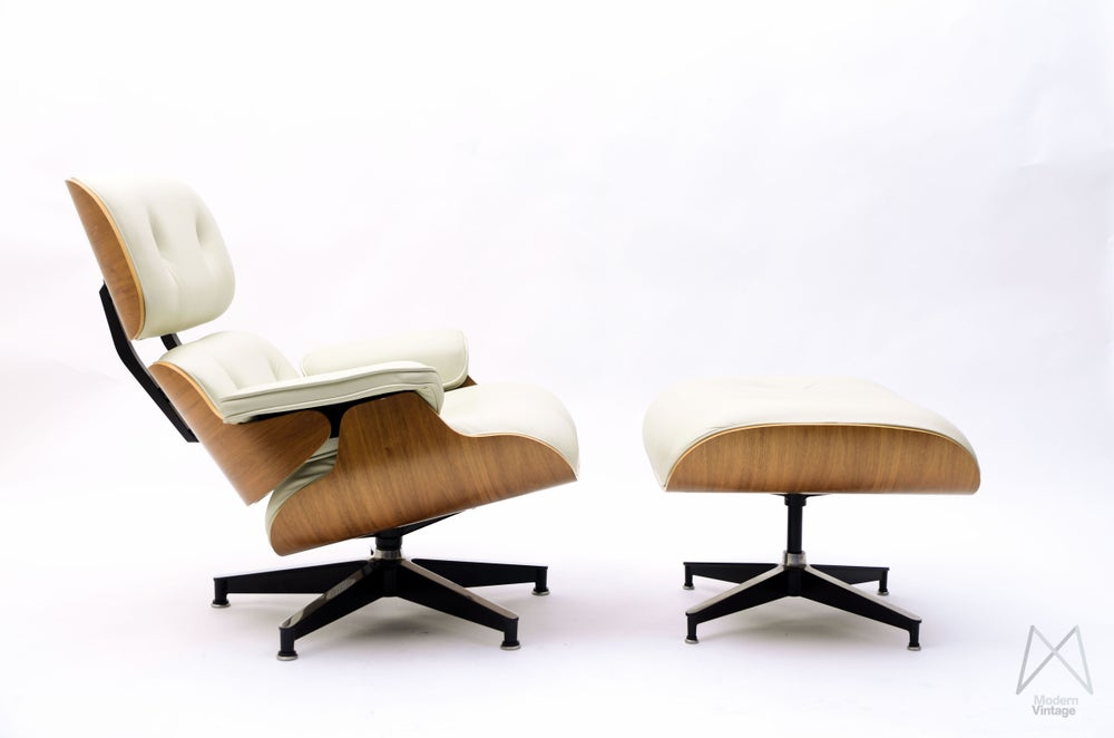 Image of Eames Lounge Chair Ottoman Walnut veneer Off white tan leather Original Herman Miller Europe