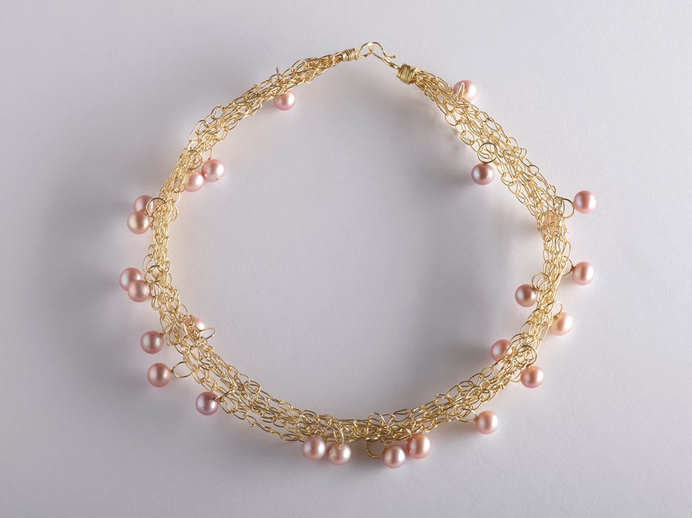 Image of Intertwined goldplated necklace with pink pearls