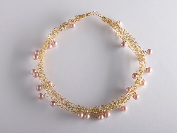 Image of necklace in goldplated silver with pink pearls
