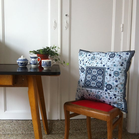 Image of unique blue and navy luxury cushion with vintage scarf