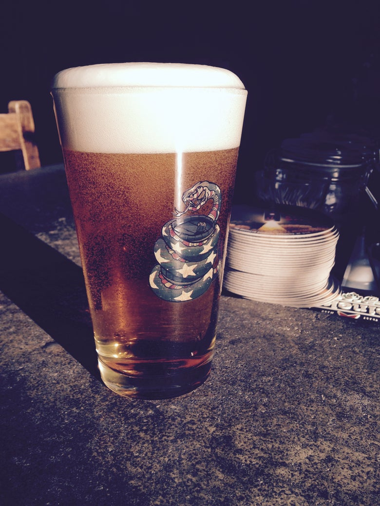 Image of WAR FLAG PINT GLASS