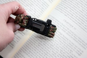 Image of 4 tools Survival Bracelet, flint, knife, whistle, rope.