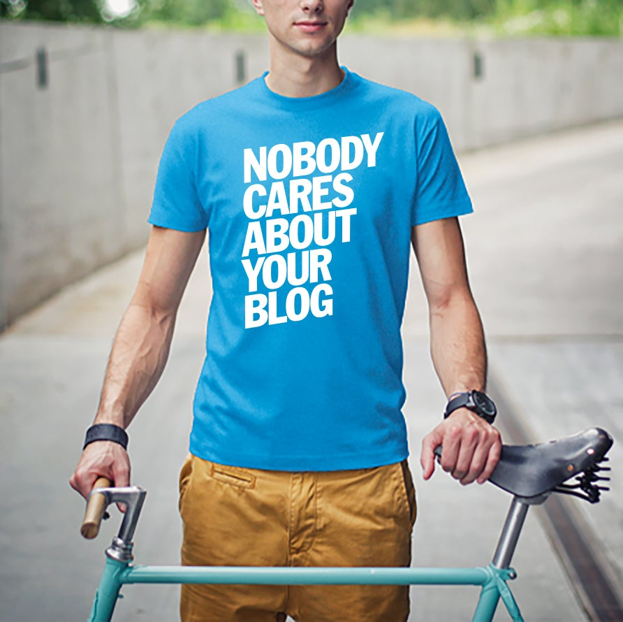 Image of Nobody Cares About Your Blog T-Shirt - White on Ocean Blue