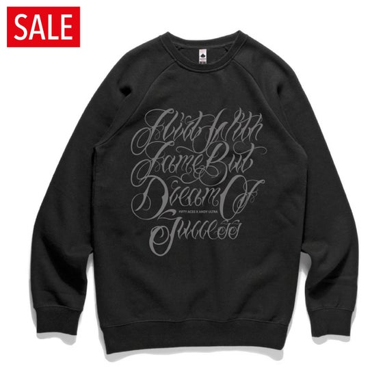 "Image of FIFTY ACES ""FLIRT WITH FAME BUT DREAM OF SUCCESS"" SWEATSHIRT BLACK"