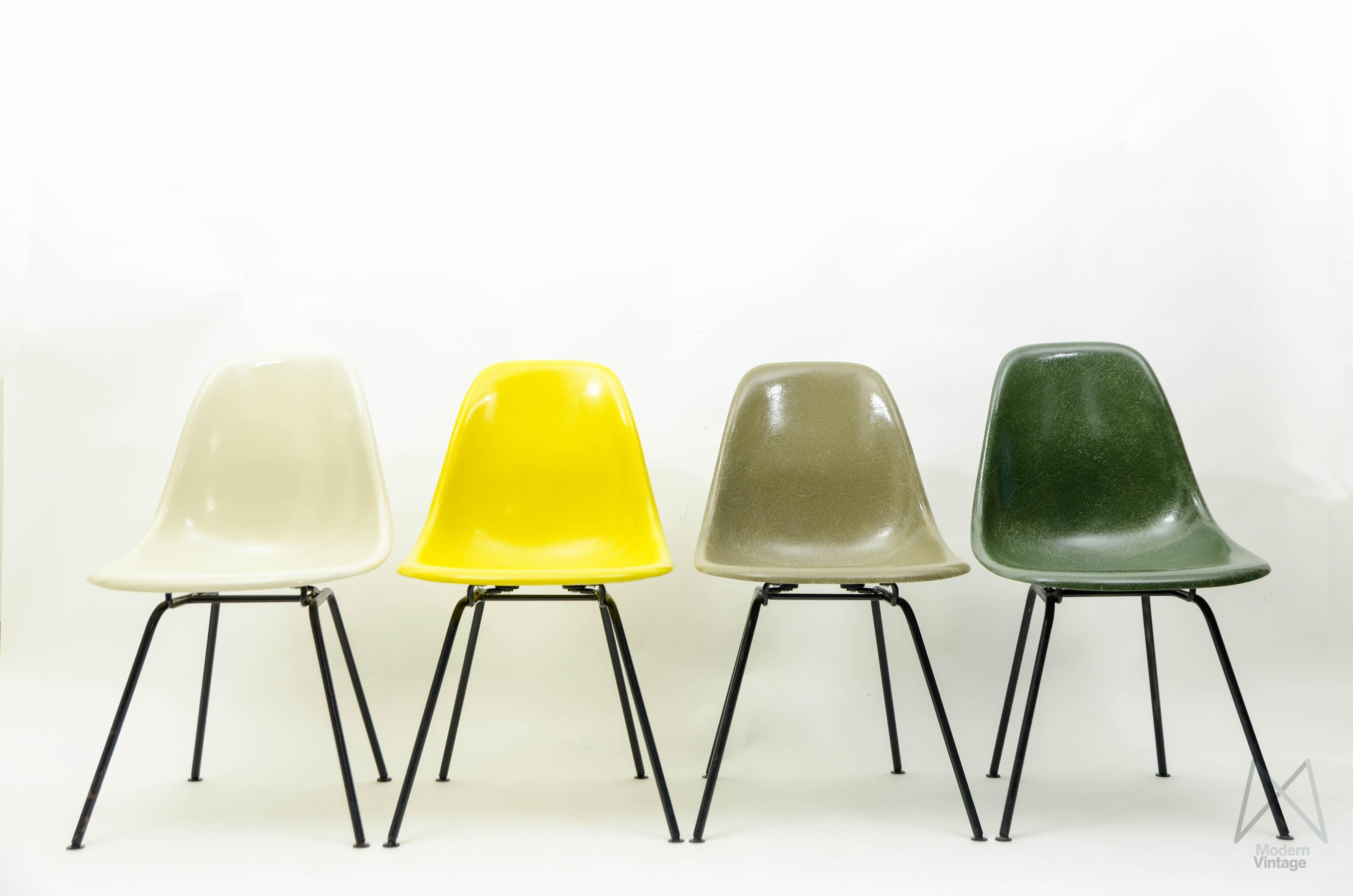 image of eames original herman miller fiberglass dsw chair set yellow green tones with dsw stol