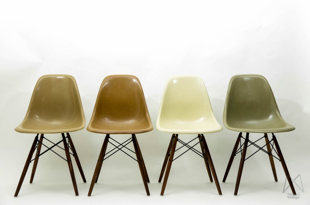 Image of Eames Original Herman Miller Fiberglass DSW Chair set natural brown tones