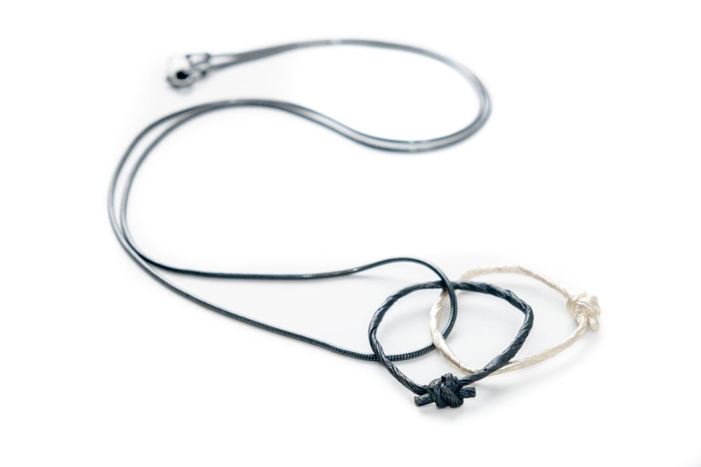 Image of oxidised knotted string pendant