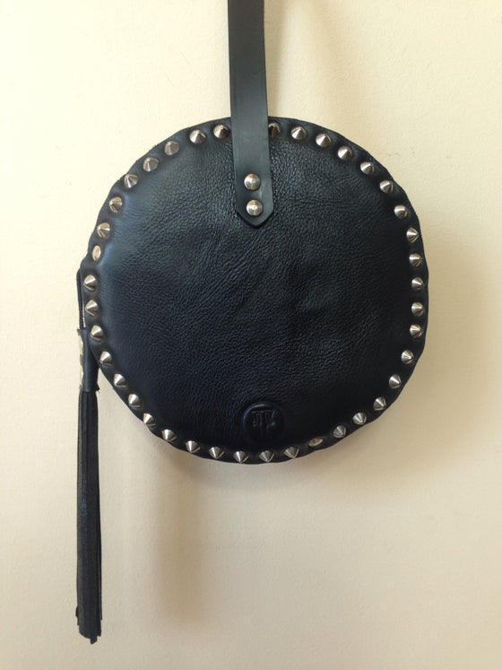 Image of Black baby drum with studs