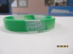 Image of GREEN AND WHITE WRIST BANDS