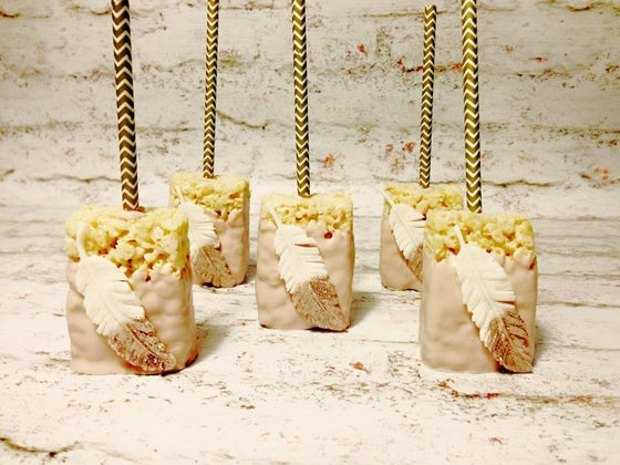 Image of Gold dipped feather rice krispy treat