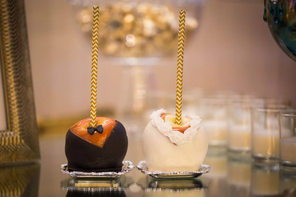 Image of Bride and groom carmel chocolate covered apple
