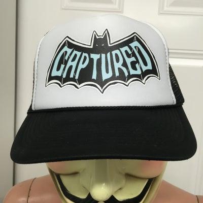 Image of CAPTURED BLACK/WHITE TRUCKER HAT