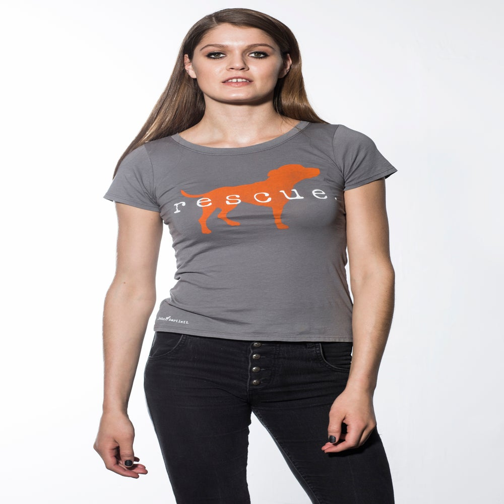 "Image of slim-fit girl's premium ""rescue"" tee. cement grey with orange dog logo."