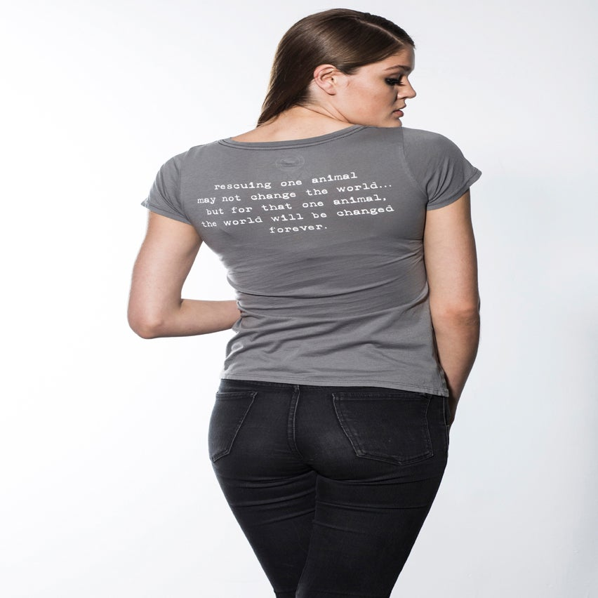 "Image of slim fit girl's premium ""adopt"" tee. cement grey body with navy dog logo"