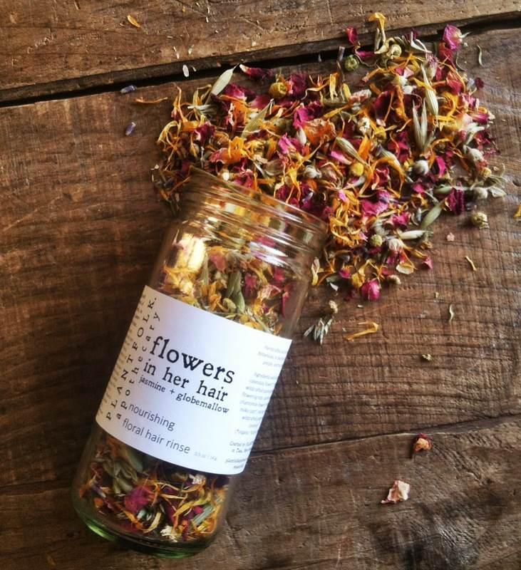 Image of flowers in her hair | nourishing floral hair rinse