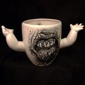 Image of Coffee mug with baby arms