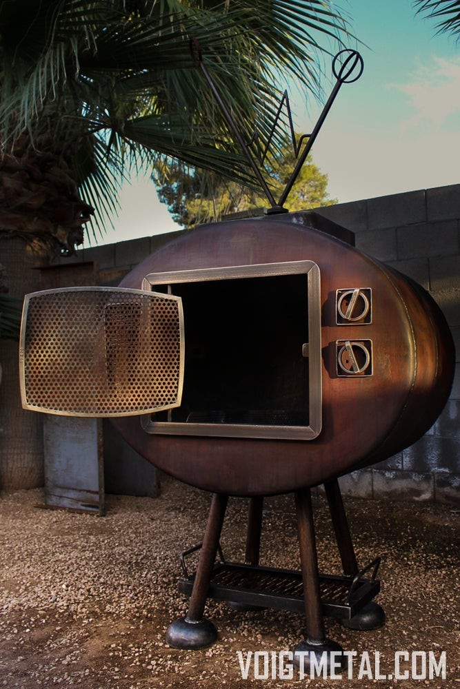"Image of ""Nothings ever on"" Voigt Metal T.V.-Outdoor wood burning fireplace"