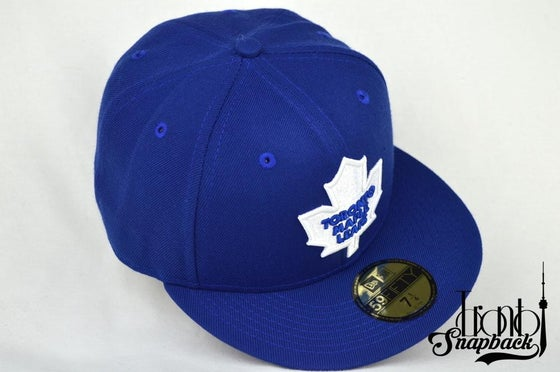 Image of TORONTO MAPLE LEAFS ROYAL BLUE NEW ERA 5950 FITTED CAP