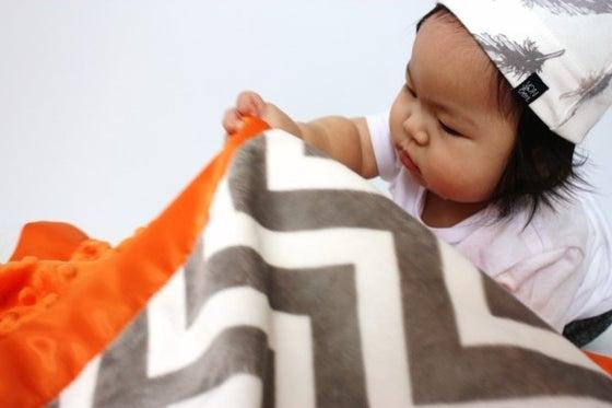 Image of BABY/ TODDLER/ ADULT BLANKET - GRAY & WHITE CHEVRON WITH ORANGE MINKY & ORANGE SATIN TRIM