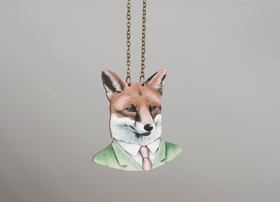 Image of The fox in a suit. Long necklace with a big wooden fox charm.