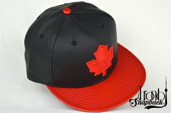 Image of TORONTO MAPLELEAFS BLACK/RED LEATHER NEW ERA 5950 FITTED CAP