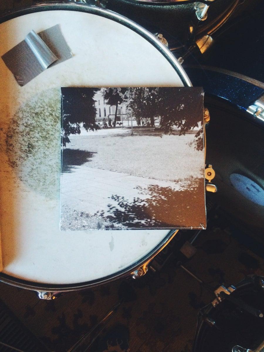 "Image of ""Talia"" b/w ""Taxying"" 7"" single."