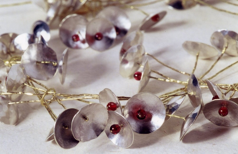Image of Sakure necklace in silver, yellow gold and garnet