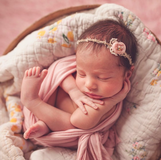 Image of newborn session | balance