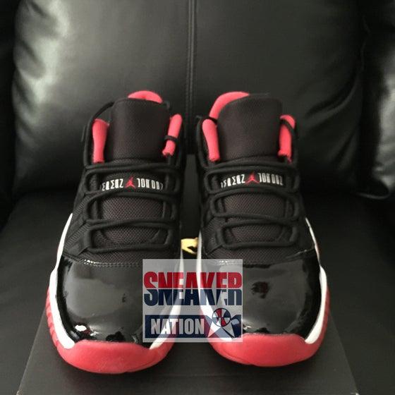 Image of Air Jordan XI bred low GS
