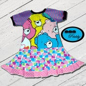 Image of **SOLD OUT**Care Bears Faces Twirl Dress - size 5/6