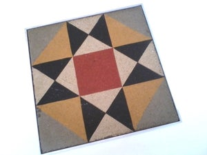 Image of Geometric grey, red with yellow trivet
